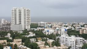 Dark clouds hover over the Landscape of Mumbai Suburb on a rainy day. High rise buildings along the sea coast in the western suburbs Versova, Andheri of Bombay stock photo