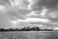 Dark clouds hovering over the water Royalty Free Stock Photography