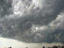 Dark Clouds. Image shows dense dark clouds hovering in the sky Stock Photo