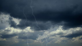Dark clouds and lightning stock footage