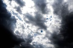 With dark clouds. Dark clouds obscured the daytime sky Royalty Free Stock Images