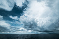 Dark clouds in open ocean Stock Photo