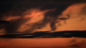 Dark clouds on orange twilight sky. Dark clouds on orange colored twilight sky stock video