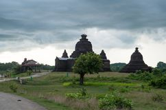 Dark monsoon clouds over the ancient pagodas of Mrauk U, Myanmar stock image