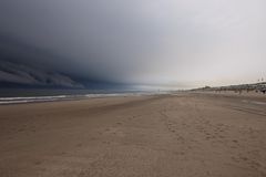 Dark clouds over beach Royalty Free Stock Image