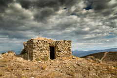 Dark clouds over a bergerie in Balagne region of Corsica Royalty Free Stock Image