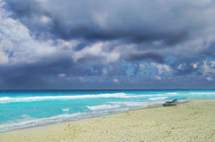 Dark clouds over blue sea and white sand Royalty Free Stock Images