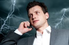 Dark clouds over businessman. Dark clouds with lightning over businessman, recesion Stock Photos