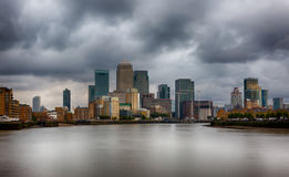 Dark clouds over  Canary Wharf, London Stock Image