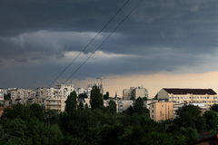 Dark clouds over the city. Announcing the storm in summer Royalty Free Stock Image