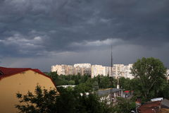 Dark clouds over the city. Announcing the storm in summer Royalty Free Stock Photo