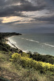 Dark clouds over coastline Royalty Free Stock Images