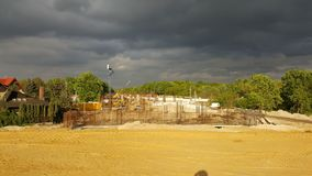 Dark clouds over the express road construction site stock photos