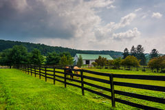 Dark clouds over a farm in rural York County, Pennsylvania. Royalty Free Stock Photo