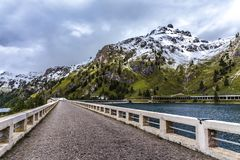 On the dam of Fedaia Lake stock photography