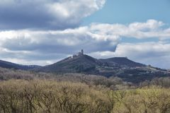 Dark clouds over the field and trees. Sky and field in the spring.Podhradie castle in Slovakia in the spring.  royalty free stock photo