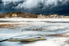 Dark clouds over a frozen lake Stock Photo