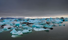 Dark clouds over a glacier lagoon Stock Image