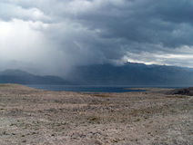Dark clouds over island Pag in Croatia in autumn Royalty Free Stock Images