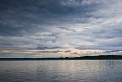 Dark clouds over the lake Stock Images