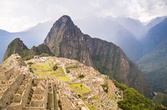 Dark clouds over Machu Picchu Inca city. Machu Picchu: Dark clouds announce the comming rain at Peru's infamous Inca city Royalty Free Stock Photo