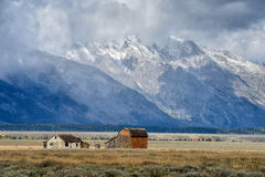 Dark clouds  over Mormon Row in Grand Teton Stock Photo