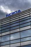 Dark clouds over Nokia logo on top of a building Stock Photos