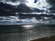 Dark Clouds over ocan beach stock photo