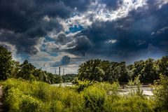 Dark clouds over the river valley stock images