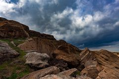 Dark clouds over rocks Royalty Free Stock Images