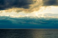 Dark clouds over the sea Royalty Free Stock Photography