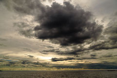 Dark clouds over the sea. Royalty Free Stock Images