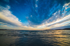 Dark clouds over the sea at sunset Royalty Free Stock Image