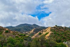 Dark clouds over Southern California mountains Stock Photos