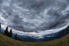 Dark clouds over a valley in the Carpathians mountains Royalty Free Stock Photos