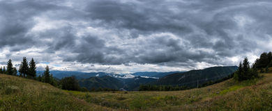 Dark clouds over a valley in the Carpathians mountains Stock Photography