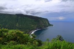 Dark clouds over Waipiʻo Valley royalty free stock image