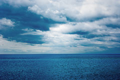 Dark clouds over the water of the sea. Summer. Royalty Free Stock Photography