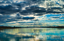 Dark Clouds over Water. Dark and stormy clouds move over a lake in Dayton, Ohio Stock Images