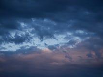Dark clouds on rainy sky Stock Image
