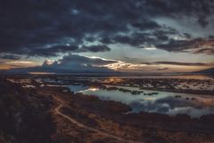 Dark clouds reflecting in water of lake Titicaca royalty free stock image