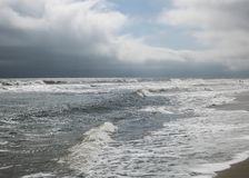 Weather Front Looming over Beach III. Dark clouds roll in from the ocean foretelling winds and rain at Carolina Beach Stock Photography