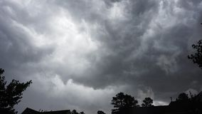 Dark clouds rush across the sky during a storm stock footage