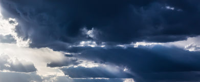 Dark clouds. Sky. Changing weather, looming clouds royalty free stock image
