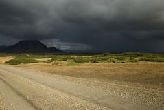Dark clouds before storm. Dark clouds are gathering just before heavy storm, Iceland Royalty Free Stock Photography