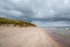 Dark clouds and stormy weather over beautiful island beach. Stock Photography