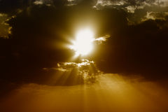 Dark clouds with sun rays. Dark clouds with orange sky and sun rays Stock Photography