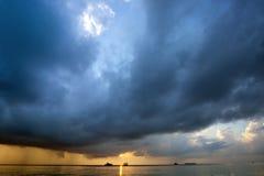 Dark clouds sunrise at Maldives Stock Image