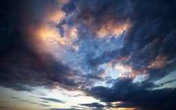 Dark clouds at sunset. Wide angle view. Royalty Free Stock Photography