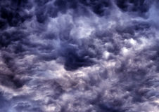 Dark clouds texture. Abstract picture of the dark stormy clouds Stock Images